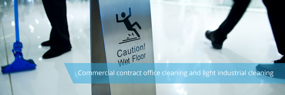 Image of two sets of feet, one close to a mop and with a sign reading 'Caution! Wet Floor' between them